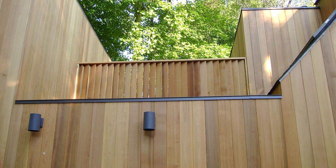 1x6 T&G Clear Western Red Cedar Siding installed vertically - home in Pennsylvania