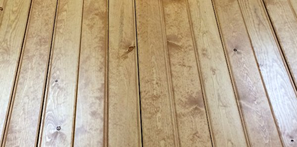 antique hand stained pine paneling