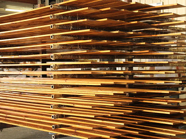 BEVEL CEDAR SIDING FACTORY PRE-STAINED ON DRYING RACKS