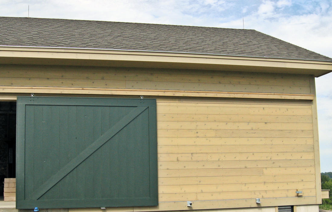 Vertical cedar siding free modernist angular residence for Horizontal cedar siding