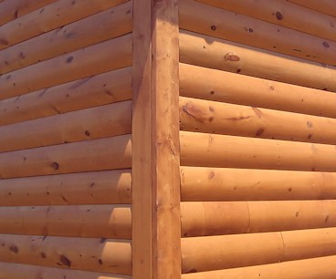 2x6 boards are a simple log siding corner option