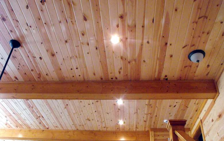 Knotty pine paneling with uv finish buffalo lumber for Tongue and groove interior wood paneling