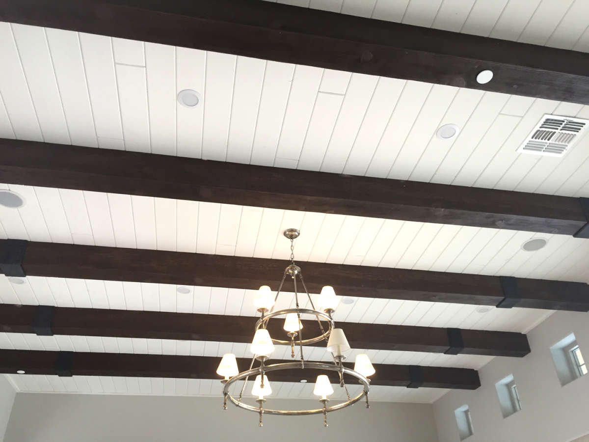 painted wood paneling on ceiling